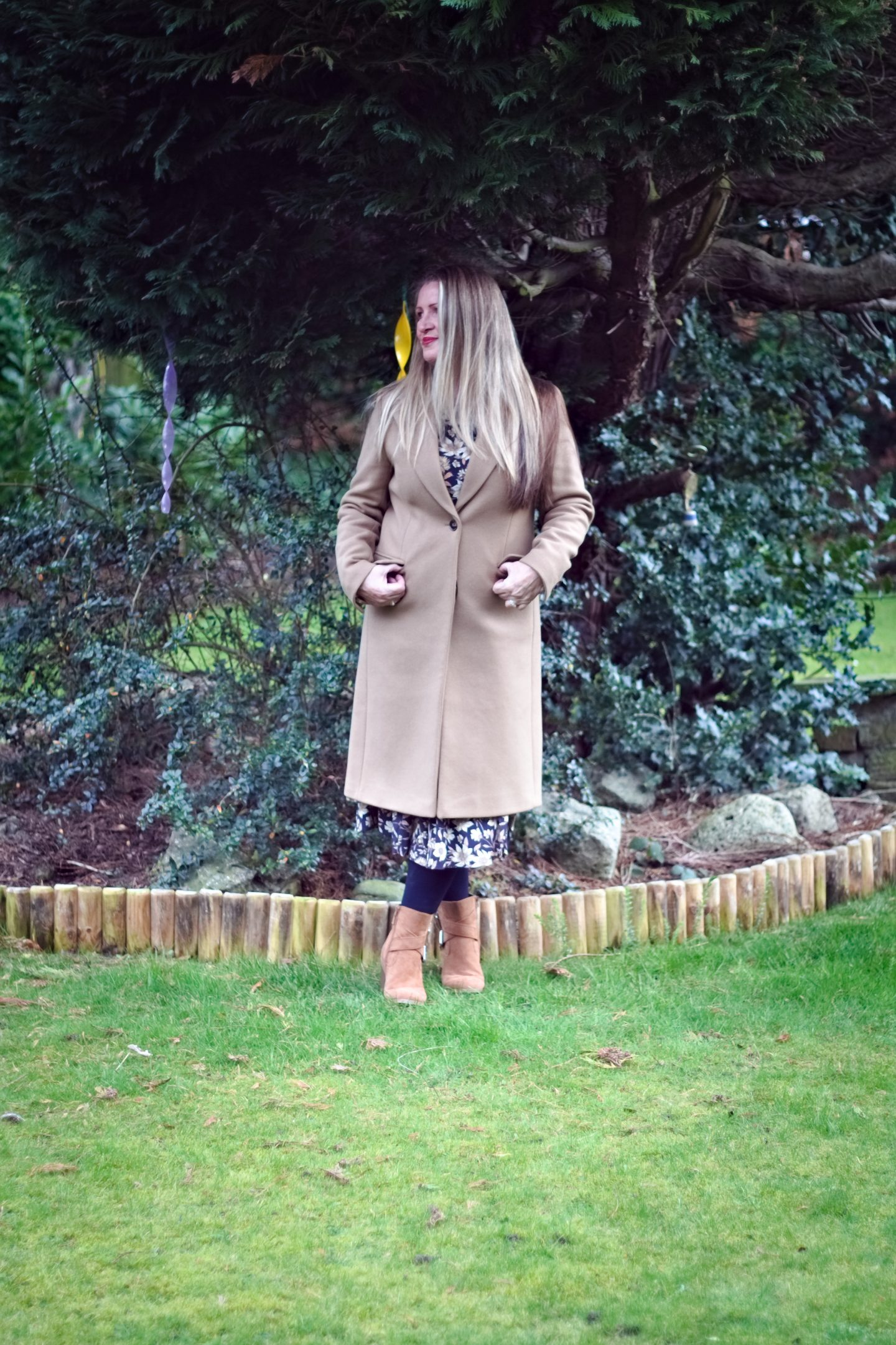 What I'm wearing right now: A classic camel coat with florals